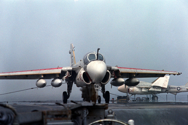 An A-6E Intruder aircraft is brought to a halt by the arresting cable during a landing on the flight deck of the nuclear-powered aircraft carrier USS DWIGHT D. EISENHOWER (CVN-69). The A-6E is assigned to Medium Attack Squadron 65 (VA-65). Seventh view in a series of eight