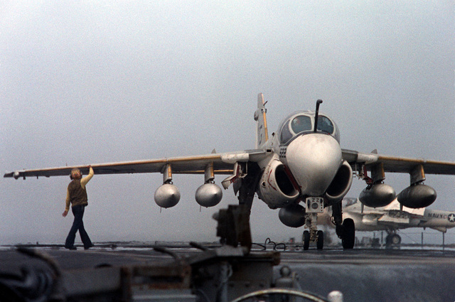 An A-6E Intruder aircraft rests on the flight deck after an arrested landing aboard the nuclear-powered aircraft carrier USS DWIGHT D. EISENHOWER (CVN-69). The A-6E is assigned to Medium Attack Squadron 65 (VA-65). Eighth view in a series of eight