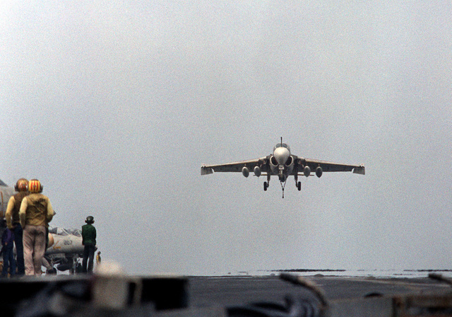 An A-6E Intruder aircraft, with its arresting hook down, approaches for a landing on the flight deck of the nuclear-powered aircraft carrier USS DWIGHT D. EISENHOWER (CVN-69). The A-6E is assigned to Medium Attack Squadron 65 (VA-65). Third view in a series of eight