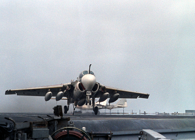 An A-6E Intruder aircraft, with its arresting hook down, prepares to engage the arresting cable during a landing aboard the nuclear-powered aircraft carrier USS DWIGHT D. EISENHOWER (CVN-69). The A-6E is assigned to Medium Attack Squadron 65 (VA-65). Fifth view in a series of eight