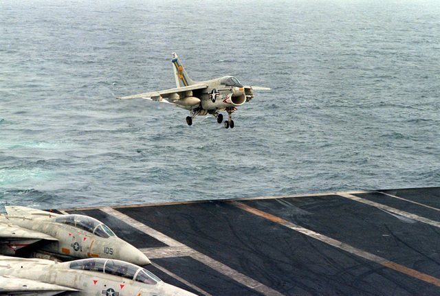 An A-7E Corsair II aircraft approaches the flight deck for an arrested landing aboard the nuclear-powered aircraft carrier USS DWIGHT D. EISENHOWER. The A-7E is assigned to Light Attack Squadron 66 (VA-66)