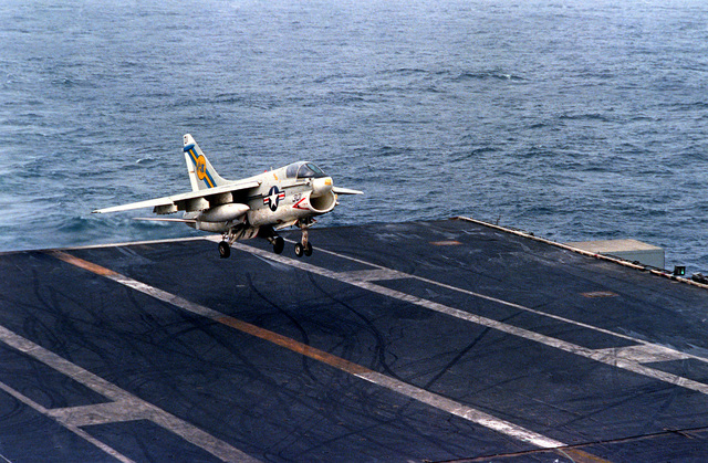 An A-7E Corsair II aircraft prepares to touch down on the flight deck during an arrested landing aboard the nuclear-powered aircraft carrier USS DWIGHT D. EISENHOWER (CVN-69). The A-7E is assigned to Light Attack Squadron 66 (VA-66)