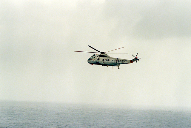 An SH-3 Sea King helicopter approaches for a landing on the flight deck of the nuclear-powered aircraft carrier USS DWIGHT D. EISENHOWER. The SH-3 is assigned to Helicopter Squadron 5 (HS-5)