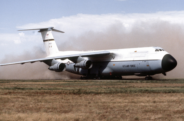 A C-5A Galaxy aircraft taxis along an unimproved runway during an operational utility evaluation test