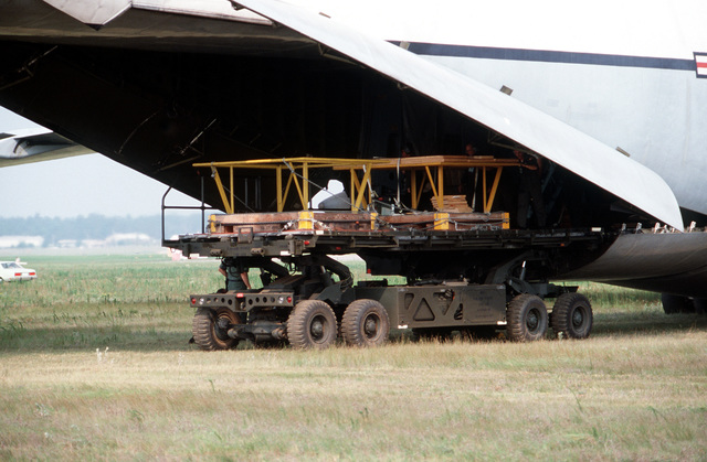 A K-loader unloads pallets as part of a C-5 Galaxy aircraft operational utility evaluation test
