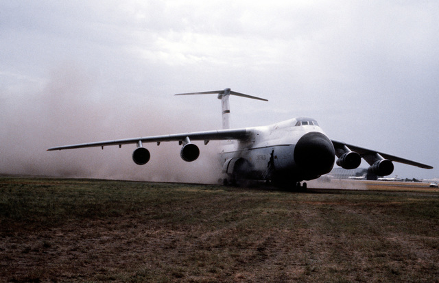 C-5A Operational Utility Evaluation Test - A left front view of a C-5A Galaxy aircraft taxiing in the dirt during an operational utility evaluation test