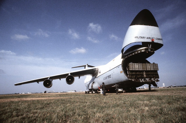 Crew members prepare to offload a C-5A Galaxy aircraft during an operational utility evaluation test