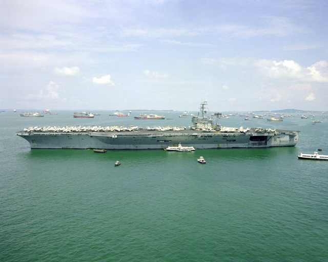 A port beam view of the nuclear-powered aircraft carrier USS DWIGHT D. EISENHOWER (CVN-69) moored in the harbor