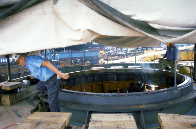 Finishing touches are made on the radar turret mount of the USNS OBSERVATION ISLAND (T-AGM-23) which is being converted to a missile and satellite tracking station. The ship conversion operation is called Project Cobra Judy