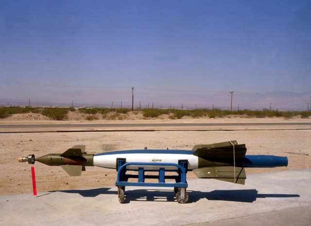 A left side view of a Skipper laser-guided bomb (LGB) with fins restrained while on a dolly