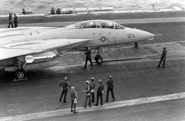 An F-14 Tomcat aircraft from Fighter Squadron 142 (VF-142) is attached to a catapult during flight operations aboard the nuclear-powered aircraft carrier USS DWIGHT D. EISENHOWER (CVN-69)