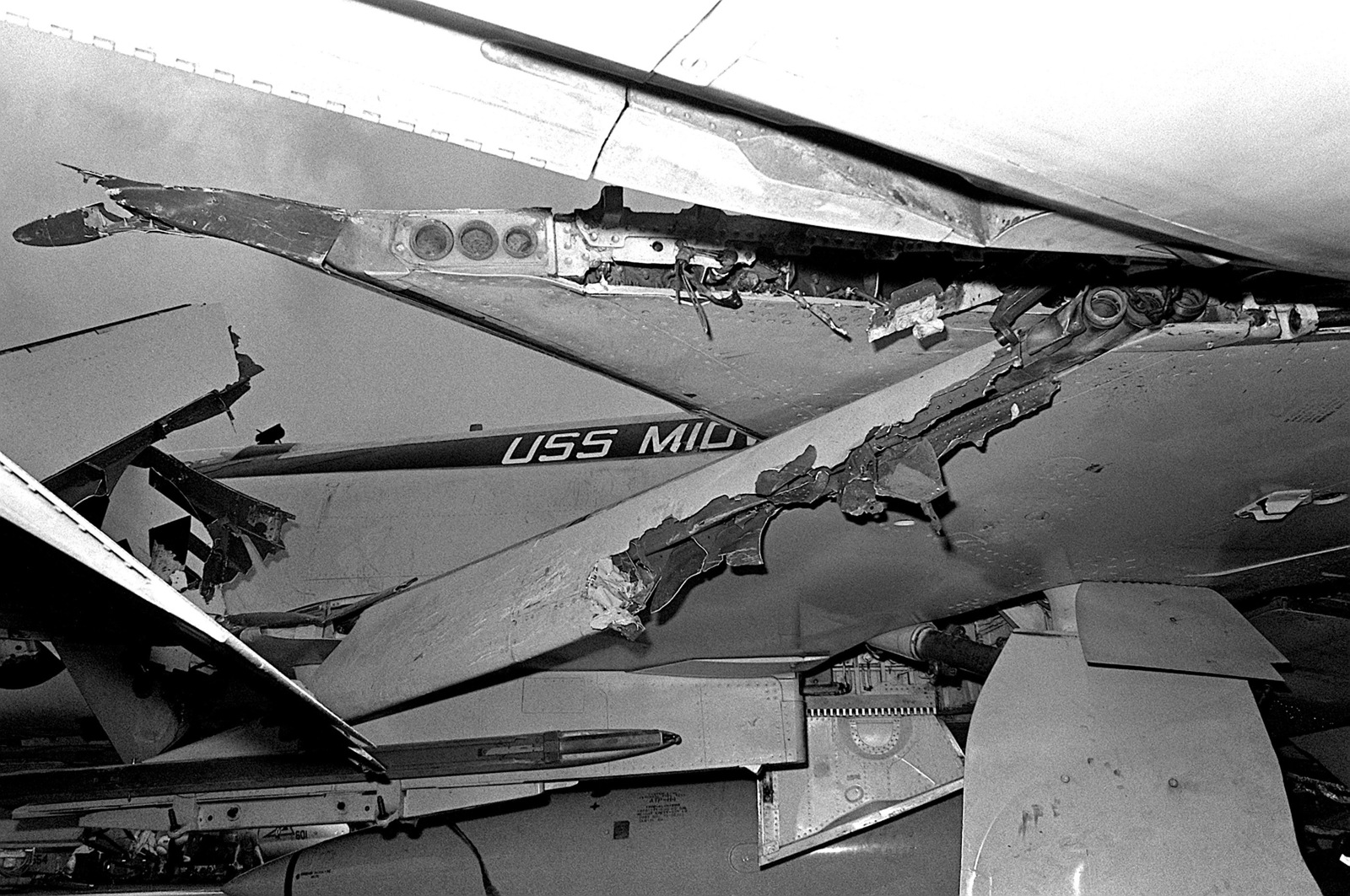 A view of damage caused to an F-4 Phantom II aircraft that was parked on the port side flight deck of the aircraft carrier USS MIDWAY (CV-41) when it collided with the Panamanian freighter CACTUS