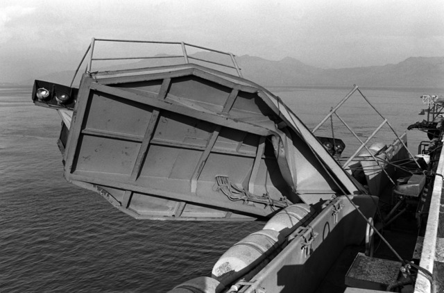 A view of damage caused to the deck edge optical landing system platform of the aircraft carrier USS MIDWAY (CV 41) when it collided with the Panamanian freighter CACTUS