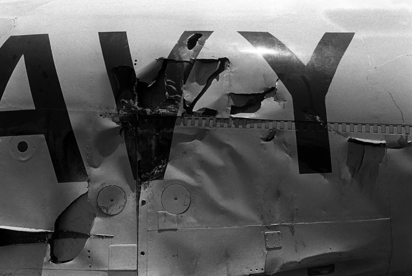 A view of damage caused to the fuselage of an aircraft when the aircraft carrier USS MIDWAY (CV 41) when it collided with the Panamanian Freighter CACTUS