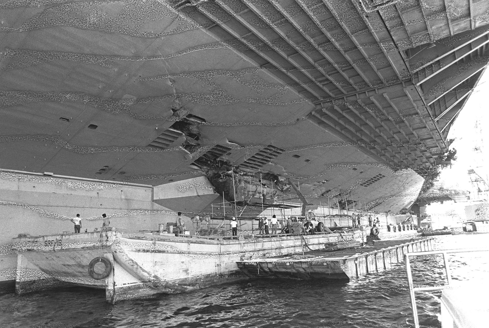 A view of damage caused to the port amidships section of the aircraft carrier USS MIDWAY (CV 41) when it collided with the Panamanian freighter CACTUS. (Substandard image)