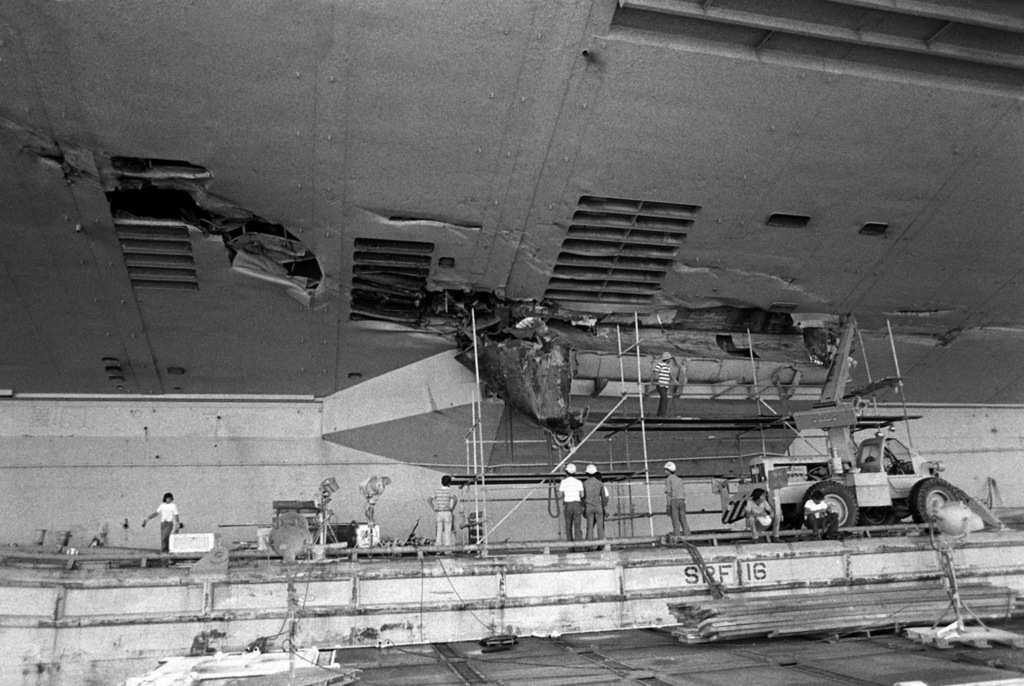 A view of damage caused to the port amidships section of the aircraft carrier USS MIDWAY (CV 41) when it collided with the Panamanian freighter CACTUS