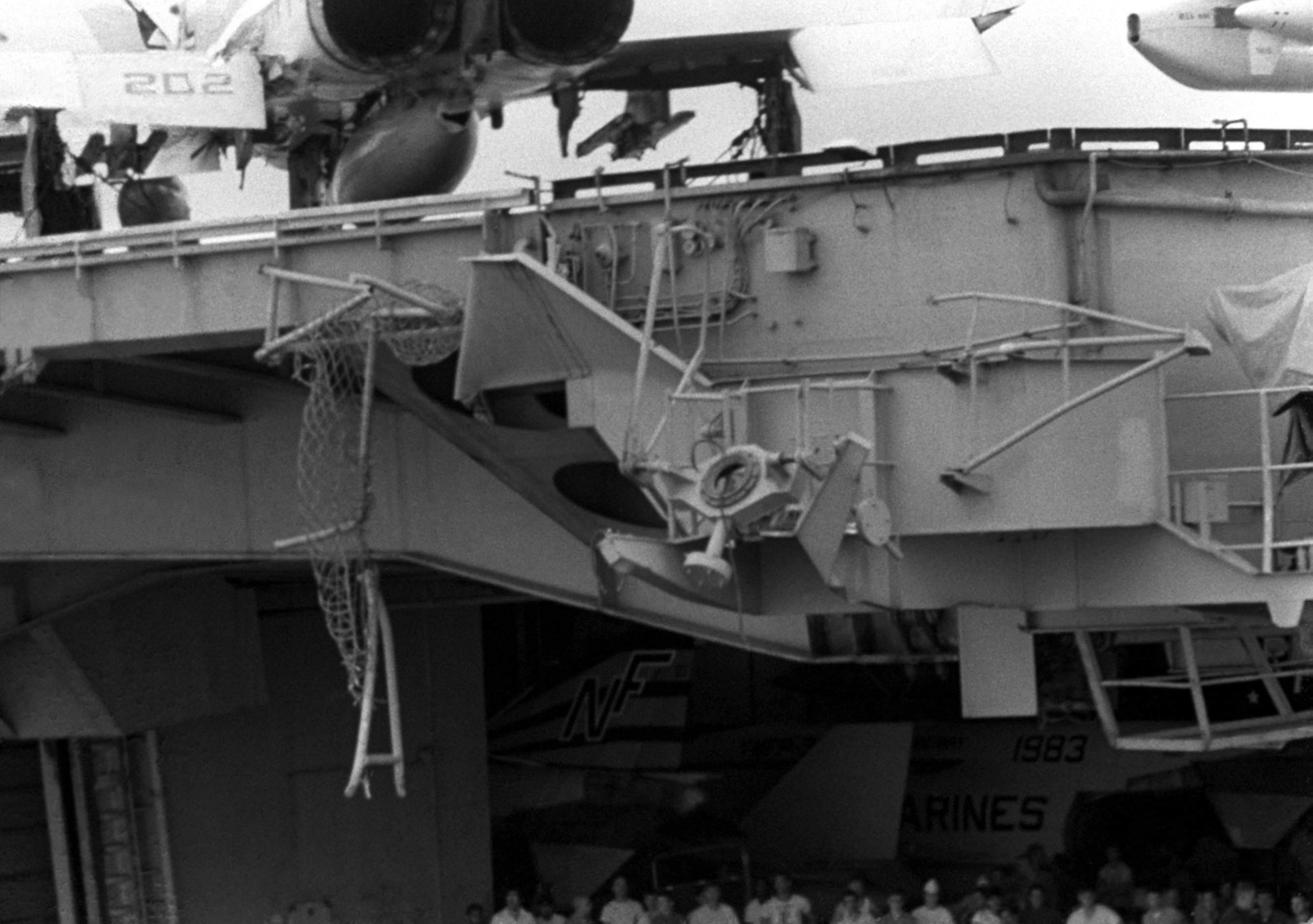 A view of damage caused to the port side aircraft elevator of the aircraft carrier USS MIDWAY (CV 41) when it collided with the Panamanian freighter CACTUS