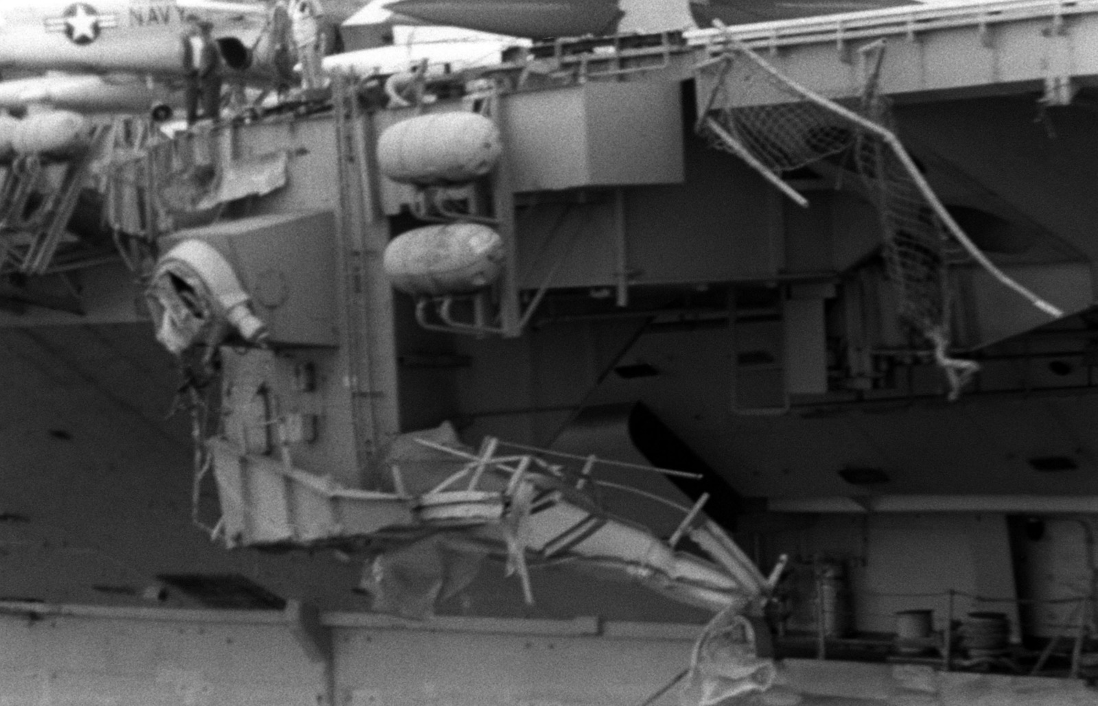 A view of damage caused to the port side of the aircraft carrier USS MIDWAY(CV 41) when it collided with the Panamanian freighter CACTUS