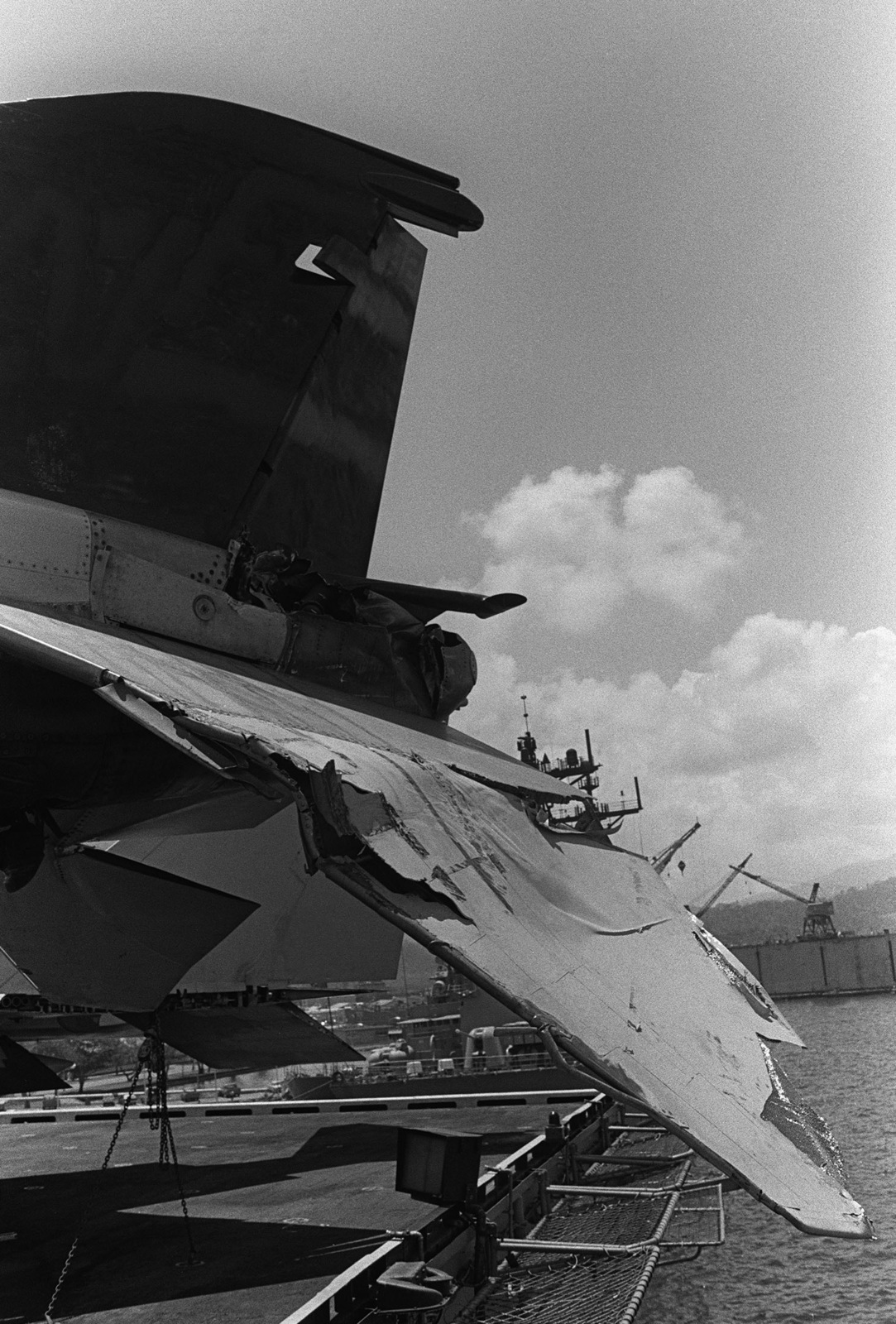 A view of damage caused to the tail section of an F-4 Phantom II aircraft when the aircraft carrier USS MIDWAY (CV 41) collided with the Panamanian freighter CACTUS