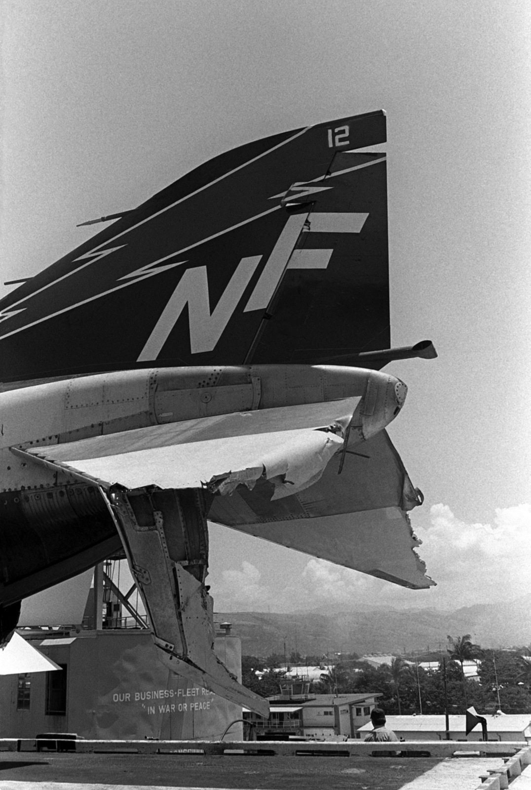 A view of damage caused to the tail section of an F-4 Phantom II aircraft when the aircraft carrier USS MIDWAY (CV 41) when it collided with the Panamanian freighter CACTUS
