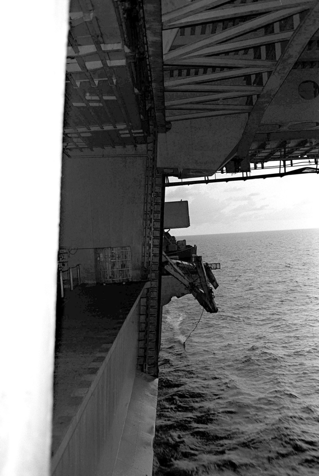 A view of damage resulting to the port aircraft elevator of the aircraft carrier USS MIDWAY (CV 41) during a collision with the Panamanian freighter CACTUS