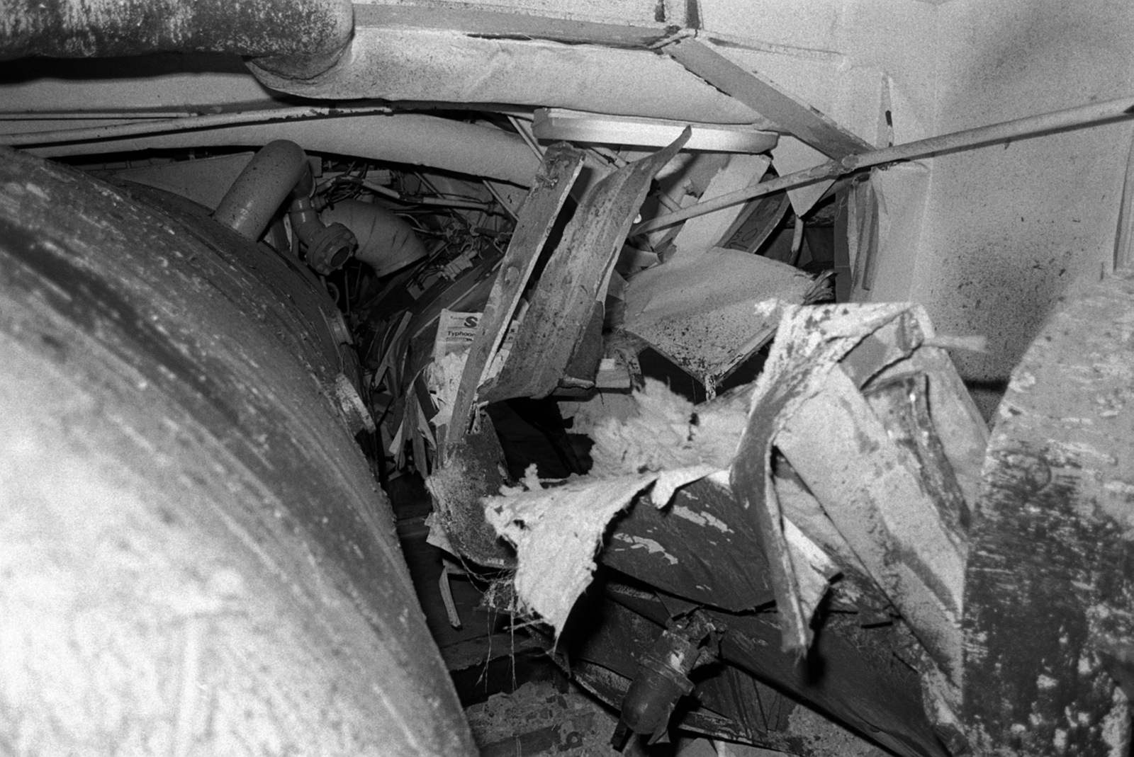 An interior view of damage caused to the aircraft carrier USS MIDWAY (CV41) in a collision with the Panamanian freighter CACTUS
