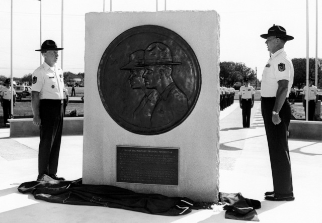 Mark Pritchett, a sculptor and a professor of art at San Antonio College, constructed this sculpture. It has the design of the Air Force military instructor's badge and their code on each side. The sculpture is dedicated to the past and present Air Force enlisted men and women