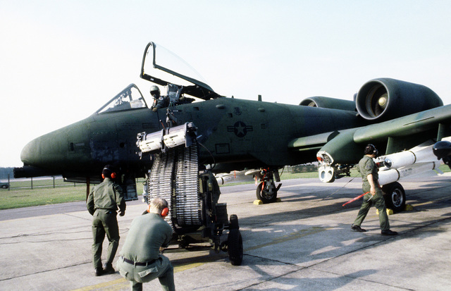 The pilot of this A-10A Thunderbolt II aircraft waits for the flight line crewmen to reload his aircraft with 30mm ammunition. They are all a part of the 81st Tactical Fighter Wing