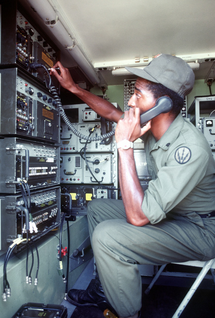 A fourth class Army specialist lines up joint tactical information distribution system (JTIDS) in a mobile Hawk missile site control complex at Ranger Camp during a training exercise