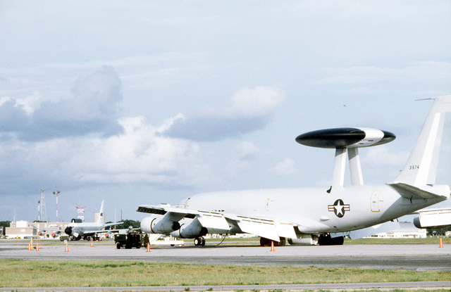A left rear view of an E-3A Sentry aircraft under maintenance service during a joint tactical information distribution system (JTIDS) training exercise