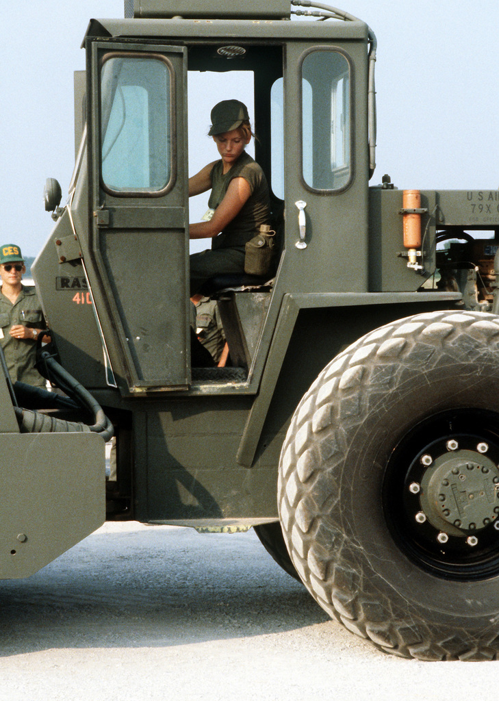 A1C Susan Miller operates a 10-ton roller used to compact crushed limestone during Prime Beef, a simulated runway attack exercise
