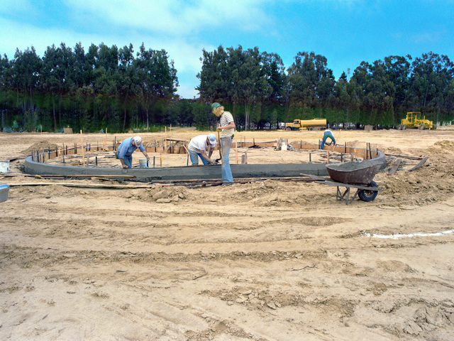 A curb of a parking island is being cemented in the MX integrated test facilities (MXITF) under construction