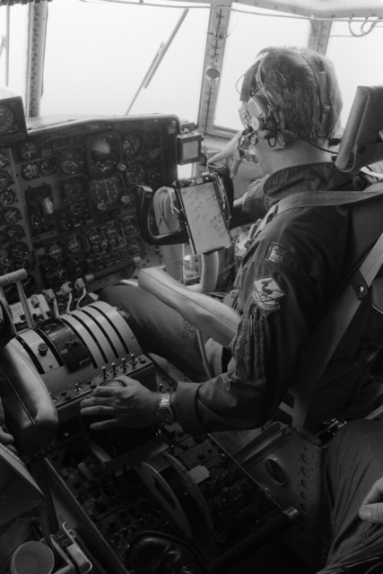 A copilot monitors instruments in the cockpit of a WC-130 Hercules aircraft of the 815th Weather Reconnaissance Squadron, 920th Weather Reconnaissance Group, during an investigation of Hurricane Allen