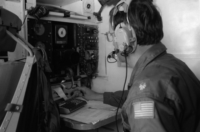 A radar operator monitors a console aboard a WC-130 Hercules aircraft of the 815th Weather Reconnaissance Squadron, 920th Weather Reconnaissance Group, during an investigation of Hurricane Allen