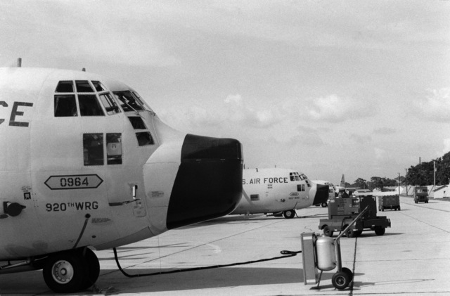 WC-130 Hercules aircraft of the 815th Weather Reconnaissance Squadron, 920th Weather Reconnaissance Group, undergo preflight maintenance on the flight line.  They are being prepared for a mission to monitor Hurricane Allen