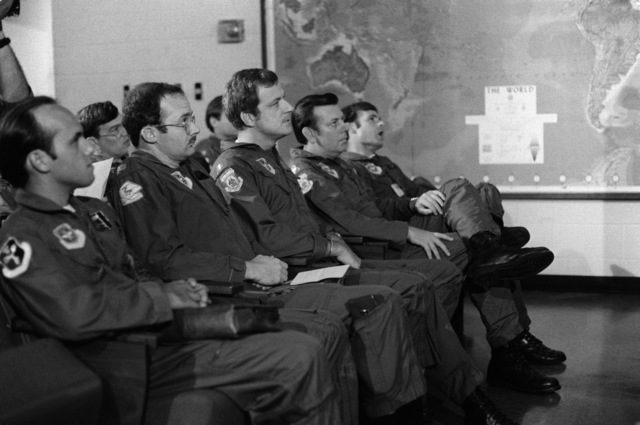 WC-130 Hercules aircrews of the 815th Weather Reconnaissance Squadron, 920th Weather Reconnaissance Group, listen to a preflight briefing.  They are preparing for a mission to monitor Hurricane Allen