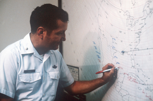 Lieutenant Colonel (LTC) Jerry F. Bonin, squadron operations officer of the 815th Weather Reconnaissance Squadron, plots the course of Hurricane Allen on a map