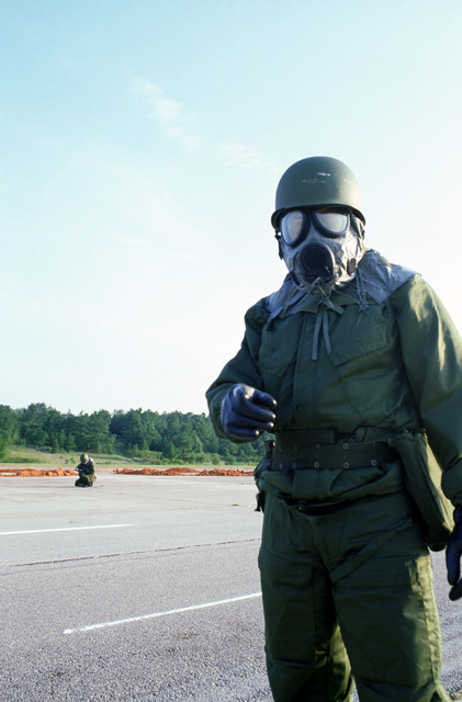 A member of a disaster preparedness team wears chemical/biological protective gear while participating in a quick reaction runway repair test