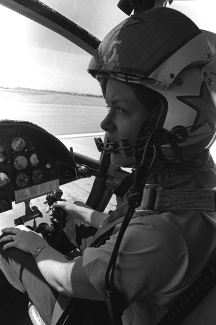 A female midshipman sits at the controls of a CH-46 Sea King helicopter prior to a demonstration flight. The midshipman is participating in a one-week aviation training program for students enrolled in the Naval Reserve Officers Training Corps (NROTC)