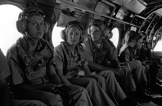 A group of midshipmen enrolled in the Naval Reserve Officers Training Corps (NROTC) wait to take off for a demonstration flight in a CH-46 Sea King helicopter. The midshipmen are participating in a one-week aviation training program designed to familiarize them with the work of the naval aviators