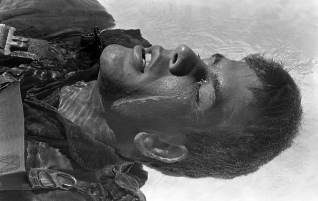 A midshipman floats on his back during water survival training at the Aviation Physiology Training Unit pool. He is participating in a one-week aviation training program for students enrolled in the Naval Reserve Officers Training Corps (NROTC)