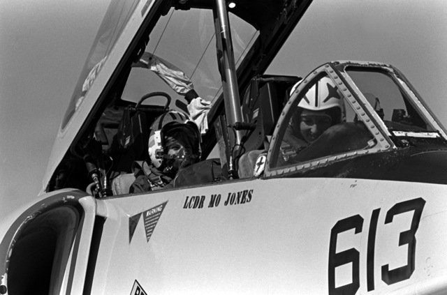 LT. Mary Jorgenson, a pilot with Fighter Squadron 126 (VF-126, prepares to take Midshipman Cindy Mason. Mason, in the rear seat, on a demonstration ride in the TA-4 Skyhawk aircraft. Mason is participating in a one-week aviation training program for students enrolled in the Naval Reserve Officers Training Corps (NROTC)