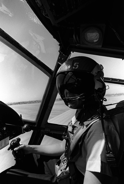 Midshipman 2nd Class Pat Corey takes the controls of CH-46 Sea Knight helicopter during a demonstration flight with Helicopter Anti-submarine Squadron 8 (HS-8). Midshipman Corey is participating in a one-week aviation training program for students enrolled in the Naval Reserve Officers Training Corps (NROTC)