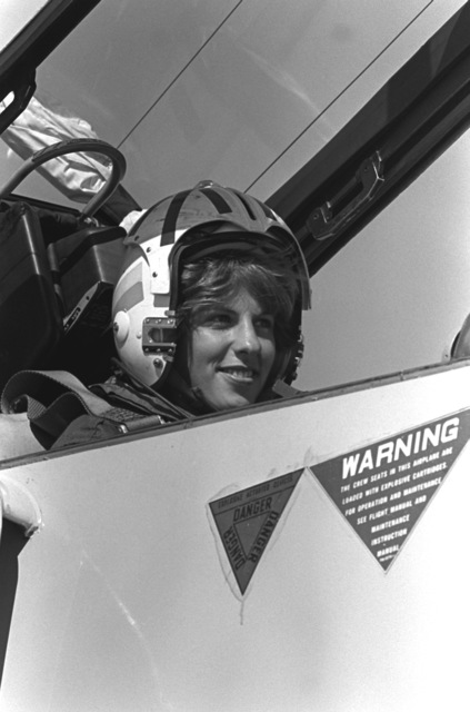 Midshipman Cindy Mason sits in the rear seat of a Fighter Squadron 126 (VF-126, TA-4 Skyhawk aircraft prior to being taken on a demonstration flight. Mason is participating in a one-week aviation training program for students enrolled in the Naval Reserve