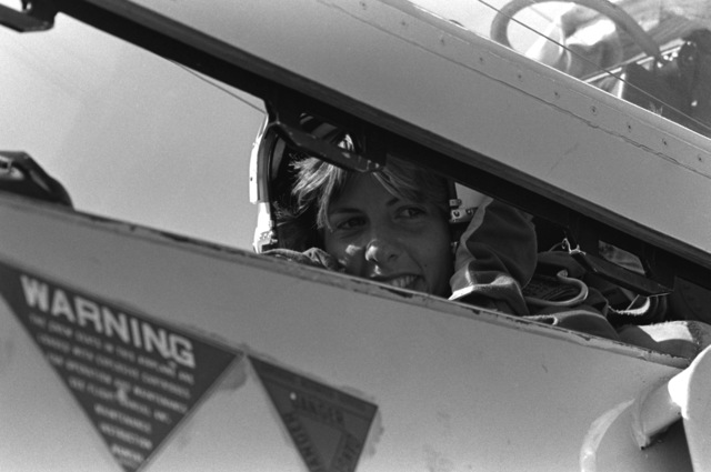 Midshipman Cindy Mason sits in the rear seat of a TA-4 Skyhawk aircraft from Fighter Squadron 126 (VF-126) prior to being taken on a demonstration flight. Mason is participating in a one-week aviation training program for students enrolled in the Naval Reserve Officers Training Corps (NROTC)