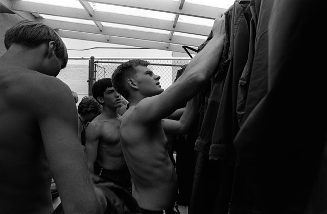 Midshipmen select flight suits to wear during water survival training at the Aviation Physiology Training Unit. The midshipmen are attending a one-week aviation training program for students enrolled in the Naval Reserve Officers Training Corps (NROTC)