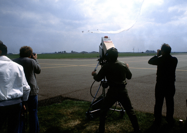 A camera crew from Detachment 3, 1361st Audiovisual Squadron, Rhein-Main Air Base, West Germany, video tapes the Red Arrows Flight Demonstration Service (AAVS) television van, not visible, is used to monitor what is being recorded