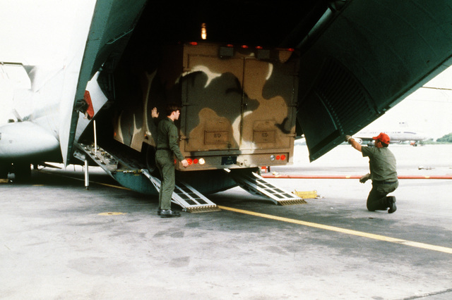 An Aerospace Audiovisual Service (AAVS) television van is offloaded from a C-141 Starlifter aircraft. The van will be used by Detachment 3, 1361st Audiovisual Squadron, Rhein-Main Air Base, West Germany