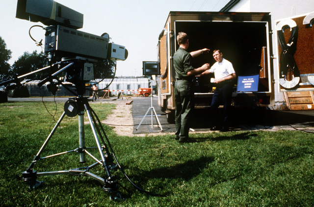 SSGT Chris Potwin, Detachment 3, 1361st Audiovisual Squadron, discusses the operations of the Aerospace Audiovisual Service television van with MAJ Guyitt, commander, Detachment 3, 1361st Audiovisual Squadron