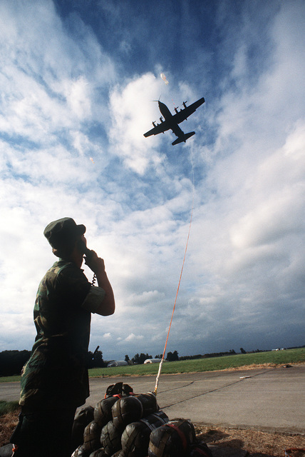The 7th Special Operations Squadron (SOS) conducts training for special air operations and related activities. The unit also trains with Army Special Forces and Navy SEALs for unconventional warfare operations. A controller coordinates with an MC-130E Hercules Combat Talon aircraft by radio as the aircraft approaches a Fulton recovery balloon